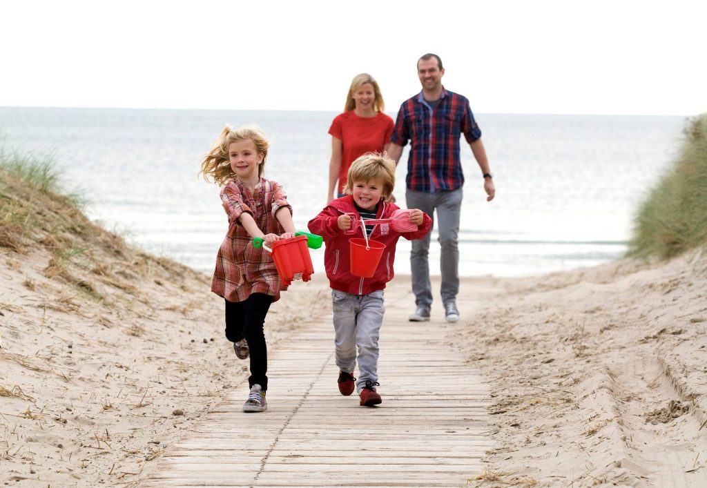 family with buckets and spades going to play on Curracloe Beach in Wexford