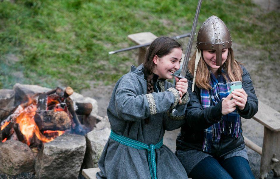 kids dressed up around camp fire Irish National Heritage Centre