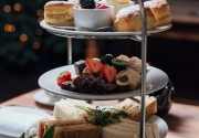 High Tea For Two In A Wintery Setting, With A Christmas Tree Blurred In The Background